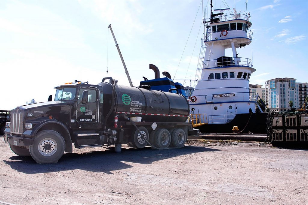 UES vacuum truck removing oily bilge slops from Tug Honour in the Port of Tampa Bay